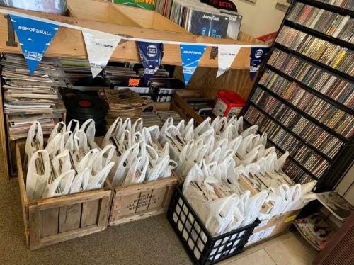 Record grab bags inside front door of Rock N Roll Land in Green Bay, Wisconsin