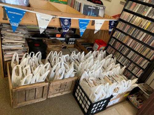 Record grab bags inside front door of Rock N Roll Land in Green Bay, Wisconsin