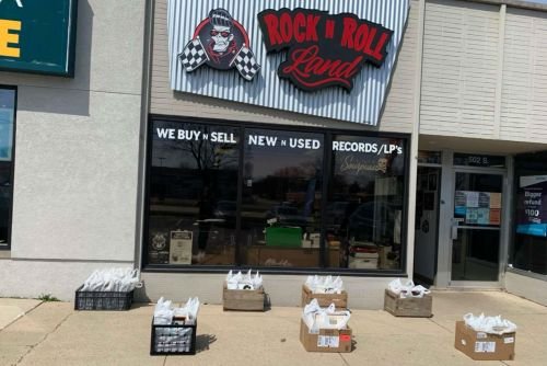 Grab bags of records outside of Rock N Roll Land in Green Bay, Wisconsin